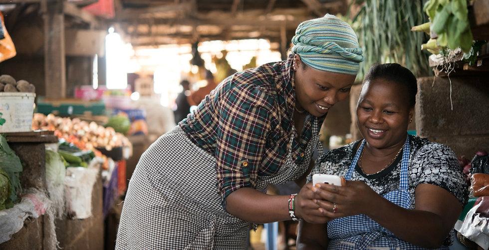 AFRICAN MARKET WOMEN PHONE.jpg