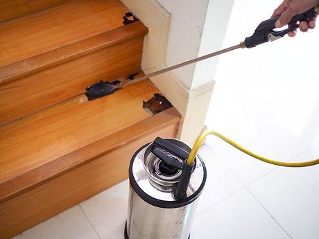 Pest control technician using equipment