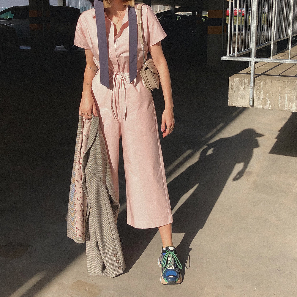 EMILIJA VISKONTAITE - stylist of STILIUSOS and social media editor of L'OFFICIEL LITHUANIA is sharing her two different outfit ideas with the same PINK JUMPSUIT from Dear Freedom 'ECO-RESPONSIBLE' collection