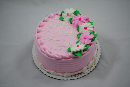 traditional round cake with pink and whi