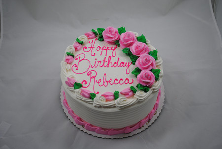 traditional round cake with pink butterc