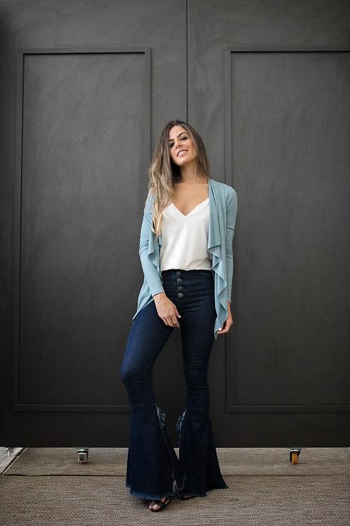 Frente da calça jeans flare abertura lateral les cloches