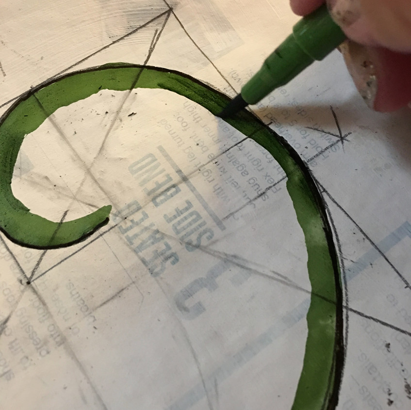 Applying the green.