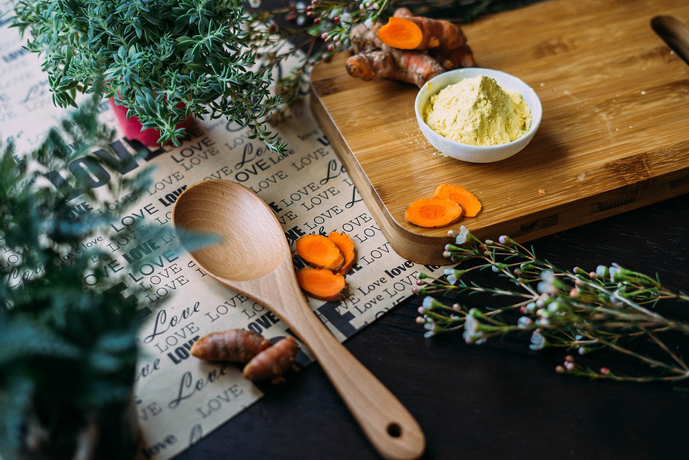 Cutting Board Surrounded by Flowers