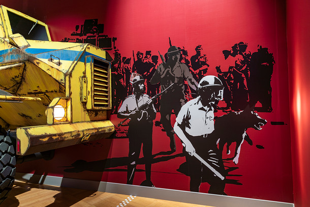 A mural depicting scenes from a riot.