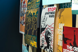A detail of protest posters that were a combination of historical reproductions and new posters created to add more volume.