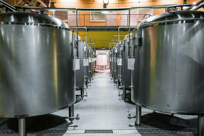 modern-beer-factory-rows-steel-tanks-storage-fermentation-beer.jpg