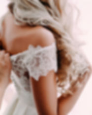 Gorgeous, blonde bride in white luxury d