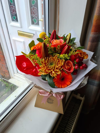 Bright Orange, Red and Yellow Handtied gift flower bouquet