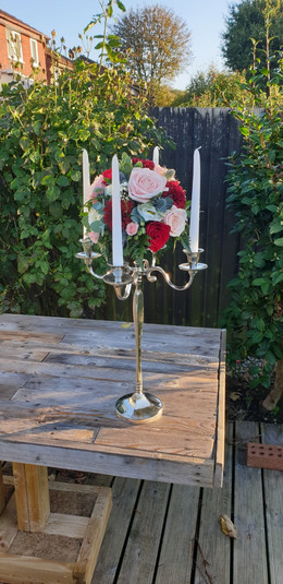 Pink and Red Rose candelabra wedding table flowers