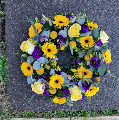 Yellow and Purple Germini Rose sympathy funeral tribute wreath flowers