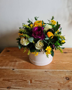 Yellow Purple and White Spring hatbox flower arrangement