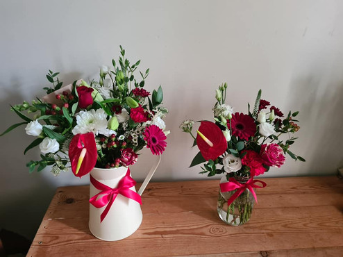 Red and White jug and jar of flowers
