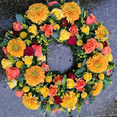 Orange, Yellow and Red large sympathy funeral tribute wreath