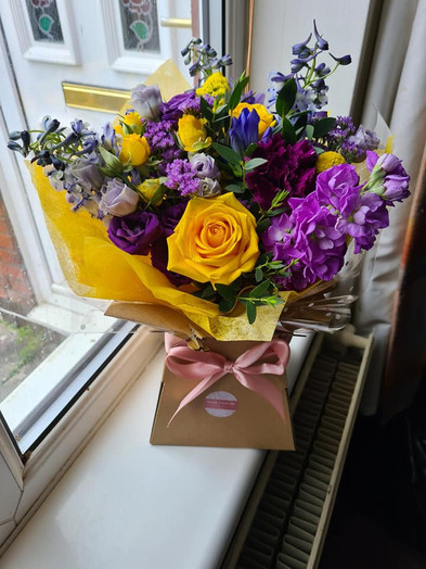 Purple and Yellow Handtied gift bouquet of flowers