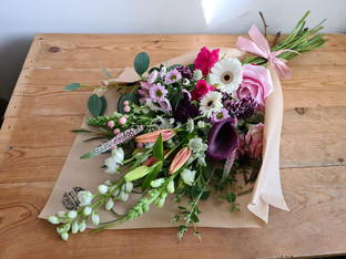 Pink Purple and White flower wrap flat bouquet