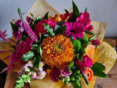 Bright vibrant orange green pink handtied gift flower bouquet