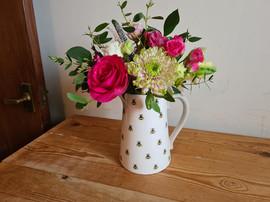 Pink jug of flowers