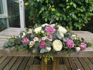 Wedding top table flower arrangement Lilac and Ivory