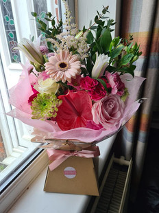 Pink front facing handtied gift bouquet of flowers