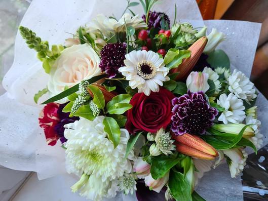 Winter handtied gift bouquet of flowers