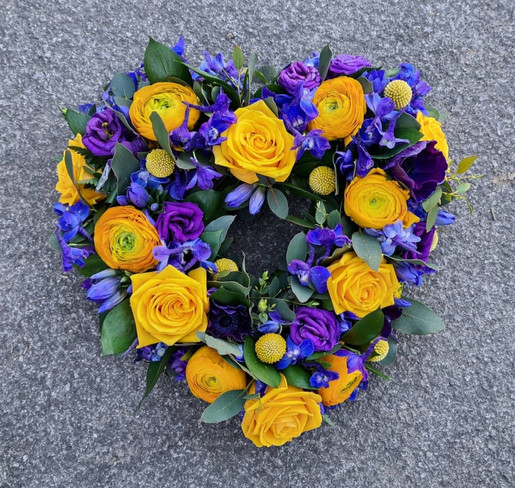 Yellow and Purple Heart sympathy funeral wreath of flowers