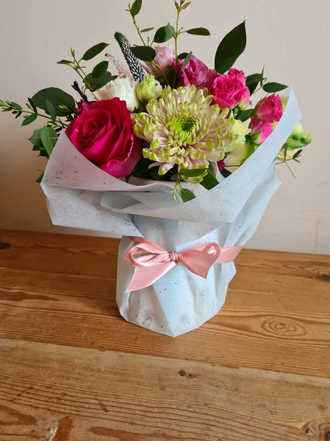 Pink jam jar of flowers