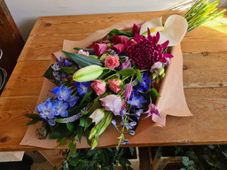 Purple, Blue and Pink flower wrap gift bouquet