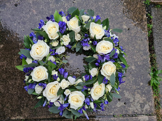 White & blue sympathy wreath funeral flowers Rose Delphinium
