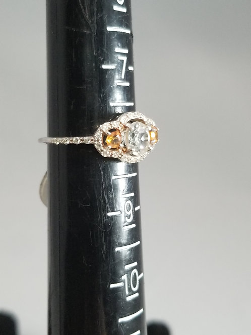 One White Topaz and Two Orange Saphire Ring