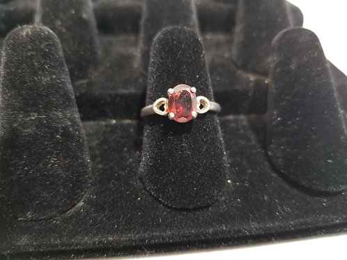 Oval Garnet Ring On Heart Band