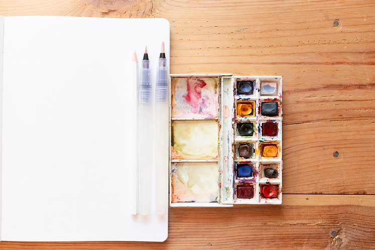 Watercolor paint canva and brushes used