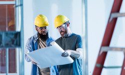 Two-construction-workers-in-building-wit