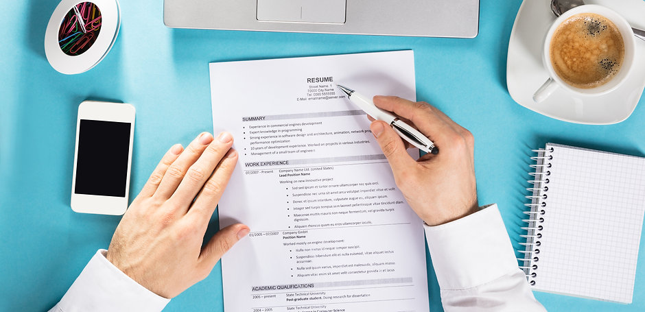 Man reviewing resume to provide medical device agencies top quality medical sales reps