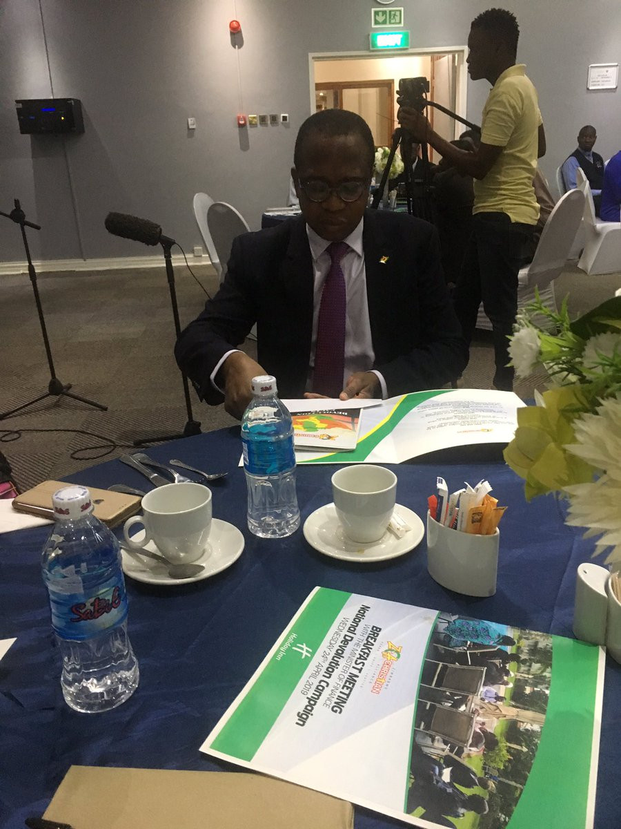 Professor Ncube going through a devolution fact sheet that was developed by Zimbabwe Christian Alliance during a devlolution breakfast meeting held at Holiday Inn, Bulawayo.