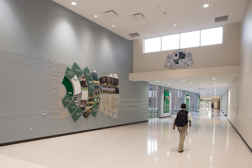 History timeline graphic, wall logo and graduates images