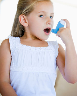 girl with asthma inhaler.jpg
