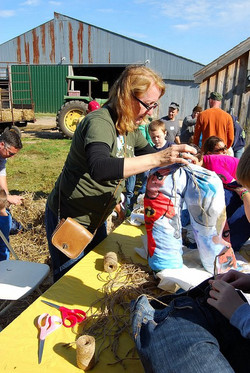 Bess making scarecrows with the kids