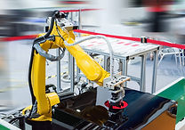 Robot arm in a factory working.jpg