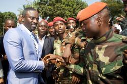 Cheering Guinean soldiers