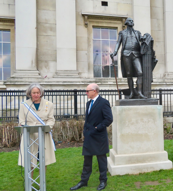 Holly Smith introduces U.S. Ambassador Johnson at the George Washington statue Trafalgar Square, February 2018.