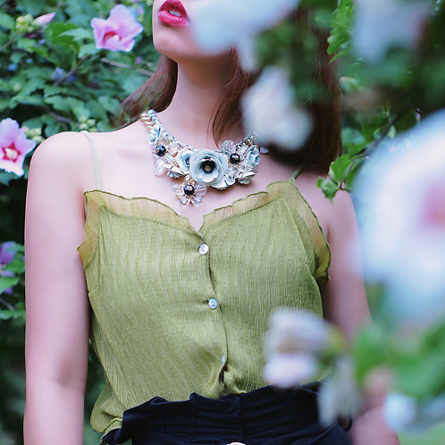 White floral necklace