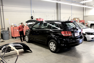 Black Car in repair shop