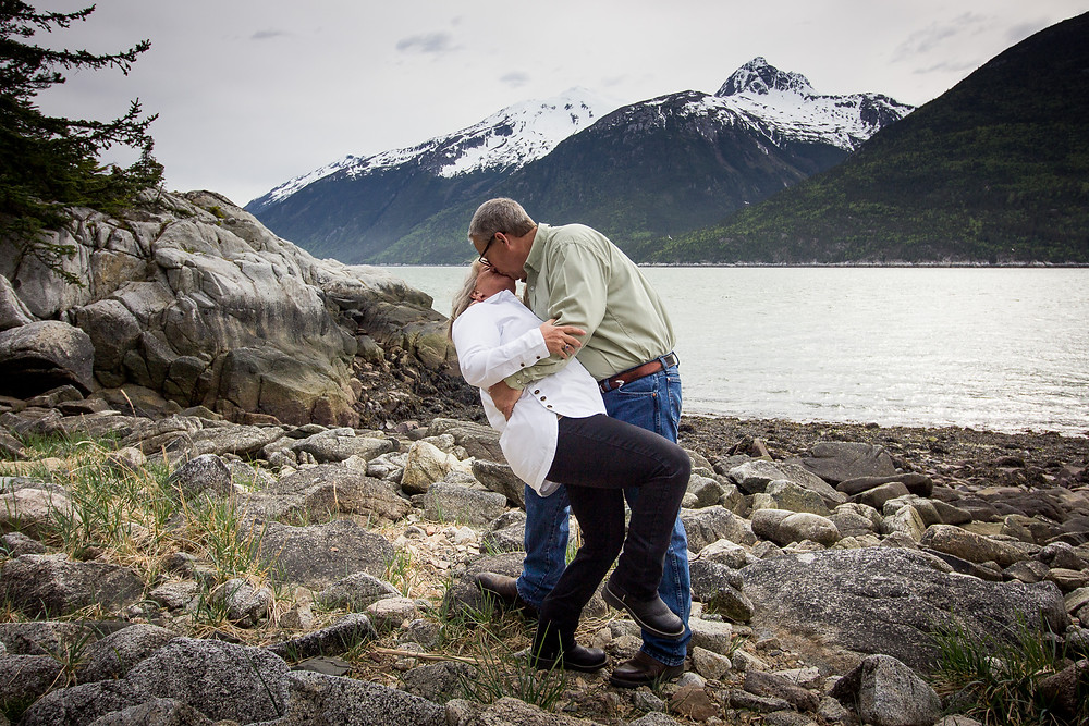 Yakutania Point venue provides an ocean and mountain backdrop for this dip n kiss.