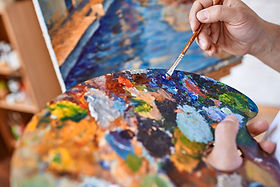 graphicstock-hand-of-artist-with-paintbr