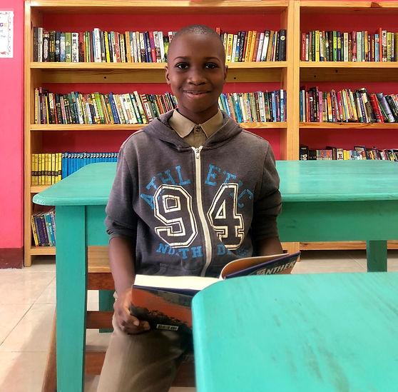 boy reading in lbrary