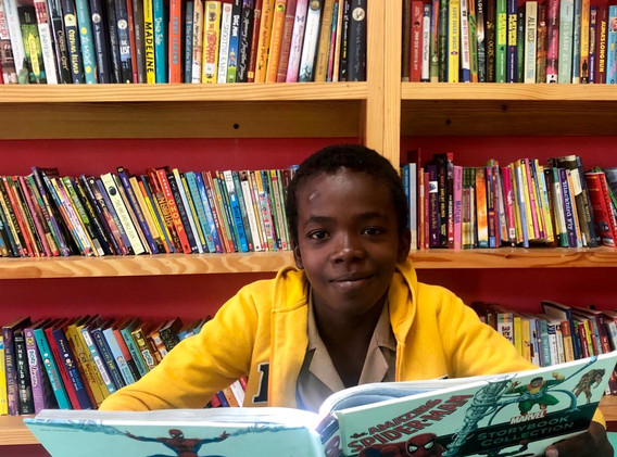 Student in ROI library, Aboukir Primary & Infant, northern Jamaica