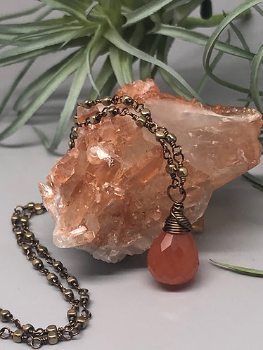 Faceted Carnelian Briolette and Gold Hematite on Antique Brass