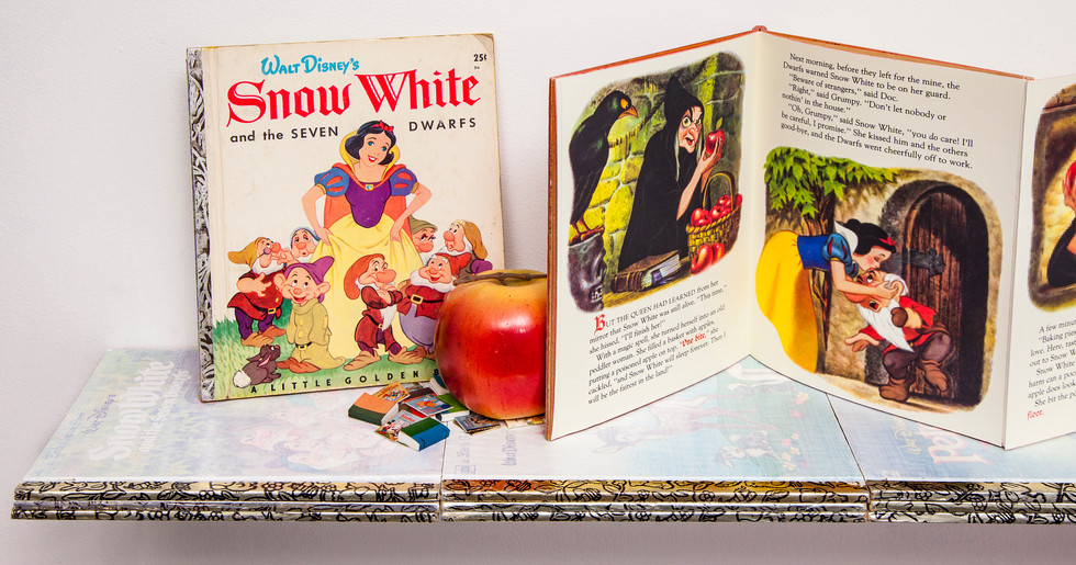 Unaltered book on left with faux apple and miniature books. First two of six fold-out illustrations focusing on witch's poison apple.