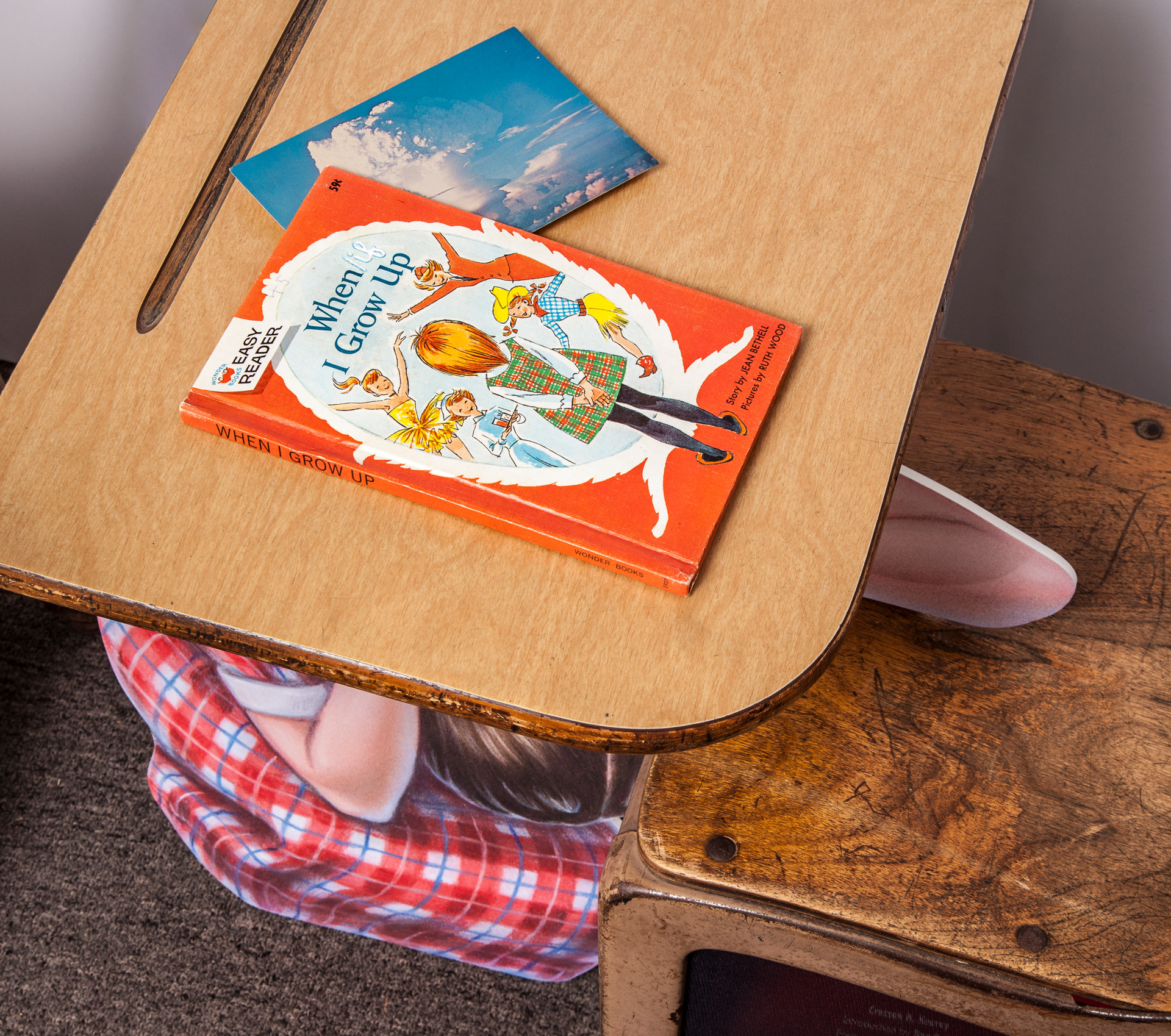 (desk top) When [if] I Grow Up, Jean Bothell, 1965; bookmark is vintage color postcard of Atomic Explosion, circa 1950.